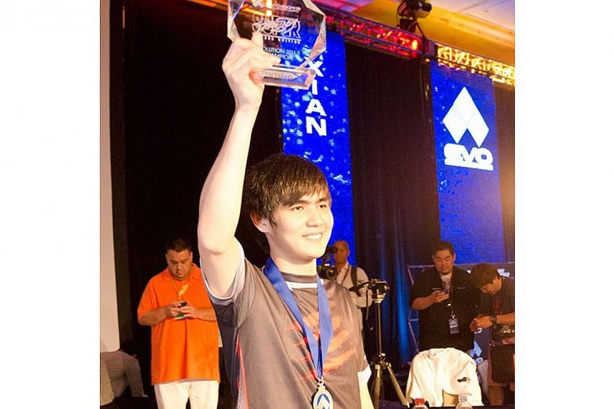 A Singaporean has for the first time topped the world's largest video game fighting tournament.Professional gamer Ho Kun Xian (above), 22, was in a neck-and-neck race with his Japanese rival in the grand finals of Evo Championships 2013 on Mond