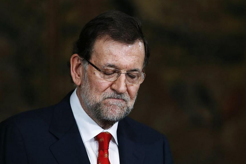 Spanish Prime Minister Mariano Rajoy (above) faced calls to explain himself or resign over his alleged support for the ruling Popular Party's disgraced former treasurer, who headed to court on Monday, July 15, 2013, over a slush fund scandal. -- FILE
