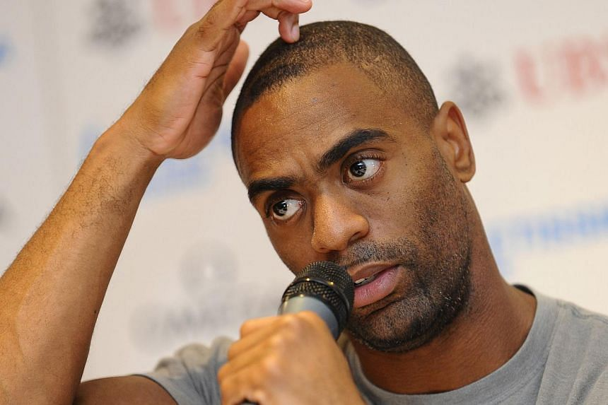 Sportswear company Adidas has suspended its contract with Tyson Gay after the former double world sprint champion failed an out-of-competition dope test, it said on Monday, July 15, 2013. -- FILE PHOTO: AFP