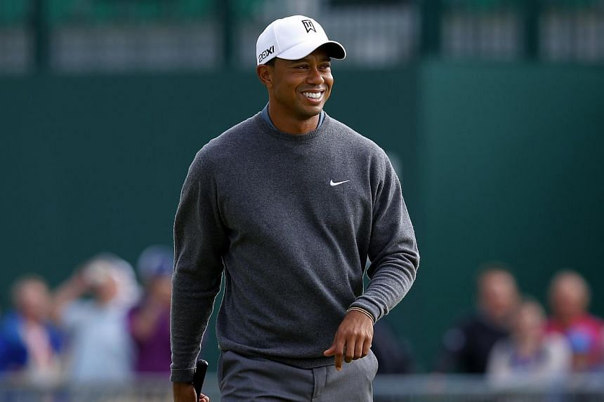 Tournament favourite Tiger Woods (above) will join Ulsterman Graeme McDowell and South African Louis Oosthuizen for Thursday's first round of the British Open. -- PHOTO: REUTERS