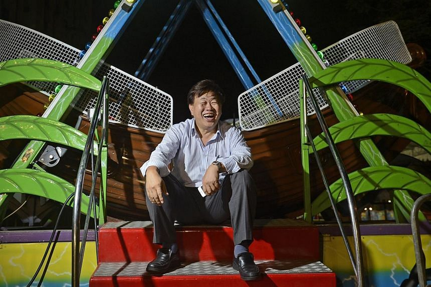 Mr Ringo Lee sees himself as a clown of sorts. He loves bringing joy to other people and especially gets satisfaction from seeing children laugh.-- ST PHOTO:DESMOND LIM