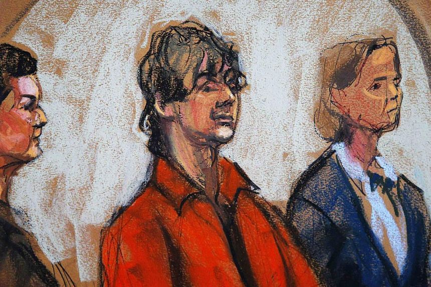 Defence attorneys Miriam Conrad (left) and Judy Clarke (right) flank Dzhokhar Tsarnaev in court in Boston, Massachusetts in this July 10, 2013 court sketch. Attorneys representing accused Boston Marathon bomber Tsarnaev on Monday asked the US Distric