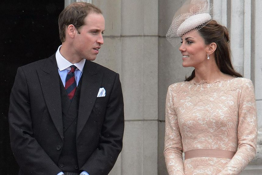 In this file pictrure taken on June 5, 2012 Prince William (left) and Catherine, Duchess of Cambridge (right) look at each other on the balcony of Buckingham Palace on the final ceremonial day of the Queens Diamond Jubilee celebrations in London. The
