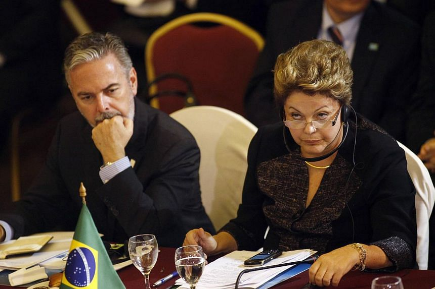 Brazil's President Dilma Rousseff (right) looks on next to Brazil's Foreign Affairs Minister Antonio Patriota while participating in the Mercosur trade bloc and special guests summit in Montevideo on July 12, 2013.Brazil said on Monday Washingt