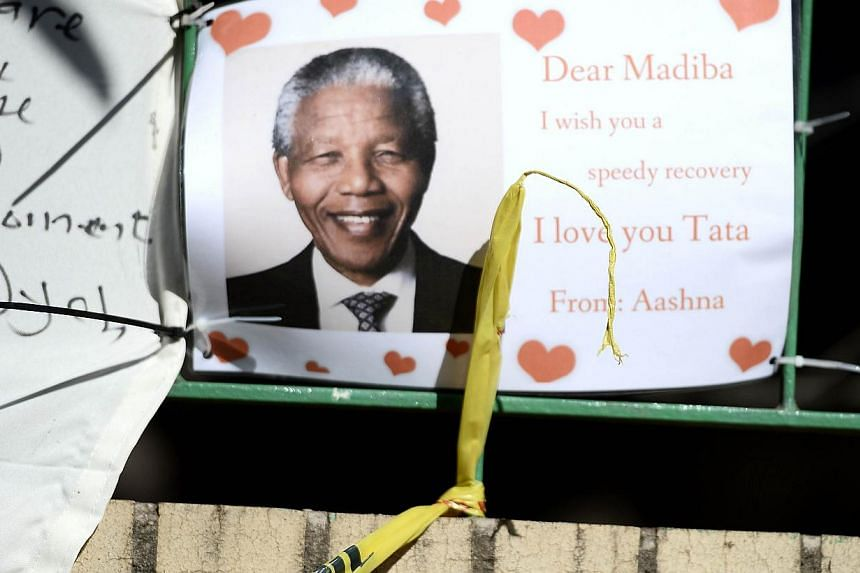 A photo taken on July 14, 2013 shows a wellwishing message for former South African President Nelson Mandela outside the Medi Clinic Heart Hospital in Pretoria. -- FILE PHOTO: AFP