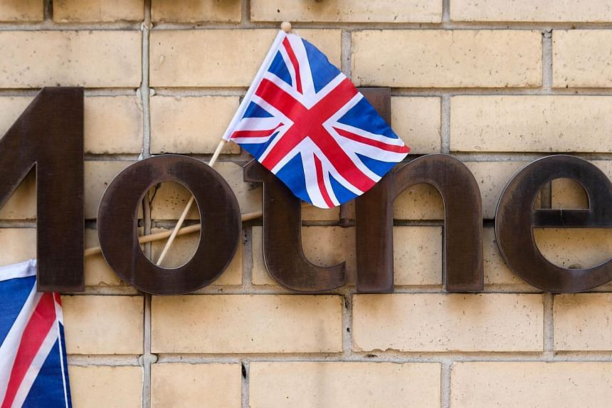 A Union Flag hangs from a sign near to the Lindo Wing of Saint Mary's Hospital in London, on July 15, 2013, where Prince William and his wife Catherine's baby will be born. -- PHOTO: AFP