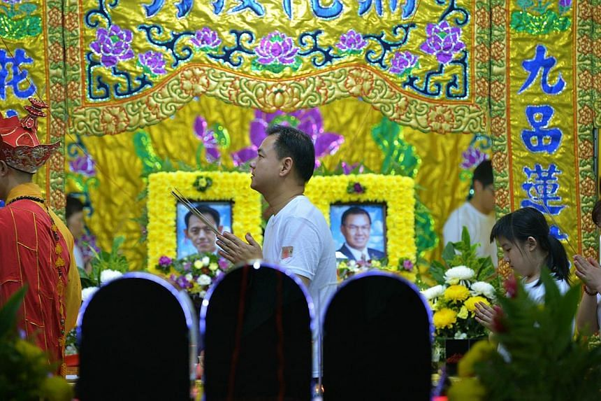 Mr Tan Chee Wee (centre), the son and brother of the Kovan double murder victims, at a prayer ceremony held at the Teochew Funeral Parlour on Monday evening, July 15. The funeral of the two victims will be held on Tuesday afternoon. Two hearses will