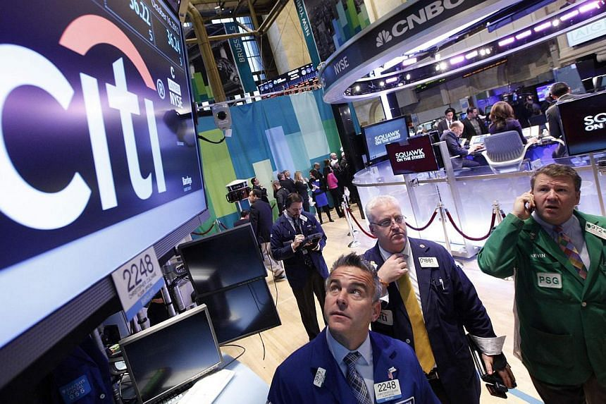 Traders work at the trading post that trades Citigroup stock on the floor of the New York Stock Exchange, in this Oct 16, 2012 photo.Citigroup's strong earnings helped the S&P 500 end higher on Monday for an eighth straight day, the longest