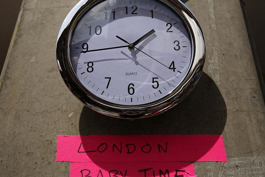 A clock in the press pen shows the time outside the Lindo Wing of St Mary's Hospital, where Britain's Catherine, Duchess of Cambridge is due to give birth, in London on July 15, 2013. -- PHOTO: REUTERS