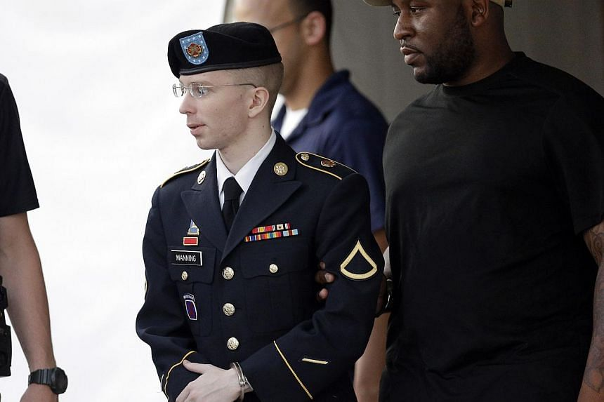 Army Pfc Bradley Manning (centre) is escorted to a waiting security vehicle outside of a courthouse in Fort Meade, Maryland on Monday, July 15, 2013, after appearing for a hearing at his court martial. A military judge will rule on Thursday, July 18,