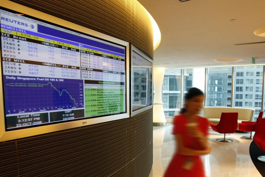 Singapore shares tumbled 0.36 per cent by midday on Tuesday, with the Straits Times Index dropping 11.69 points to 3,225.13 by 12.15pm. -- ST FILE PHOTO:BRYAN VAN DER BEEK