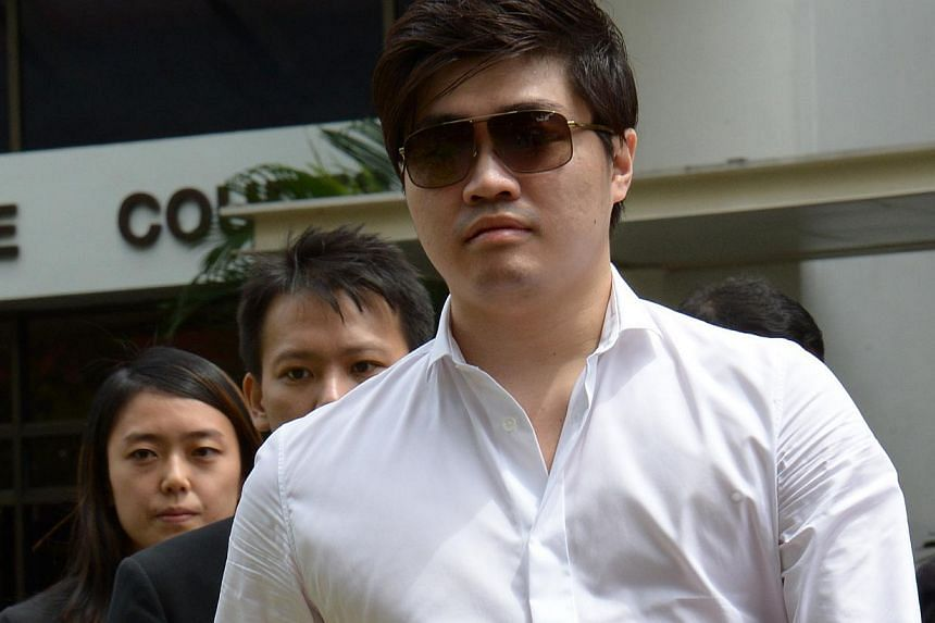 Ding outside the courthouse yesterday. He is accused of bribing three officials to fix a match by arranging sexual favours for them.