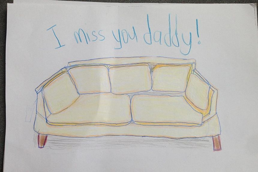 (Left) A drawing of the sofa the family was expecting to be delivered last week, done by Mr Tan Chee Heong's 10-year-old son.  Police officers and divers looking for the murder weapon in the waters near  the National Sailing Centre at East Coast Park
