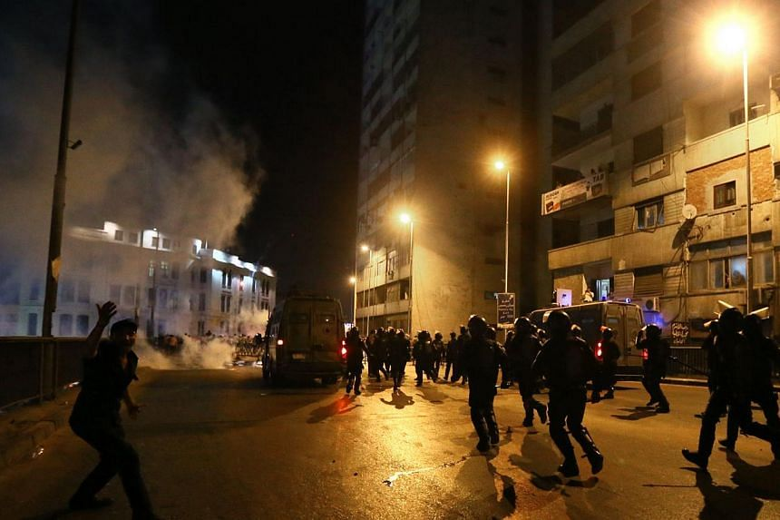Egyptian riot police disperse supporters of the Muslim Brotherhood and Egypt's ousted president Mohamed Mursi near the Six October bridge in the centre of Cairo on Tuesday, July 16, 2013. Egyptian security forces arrested more than 400 supporters of