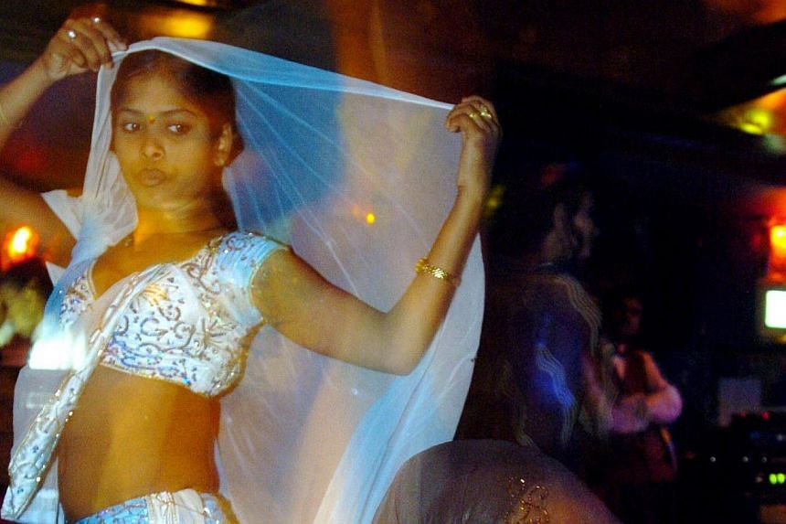 In this photograph taken on May 6, 2005, Indian bar dancers are performing during their evening perfomance in Mumbai. India's top court overturned a ban on dance bars in Mumbai July 16, 2013, allowing hundreds of premises that employ women to dance a