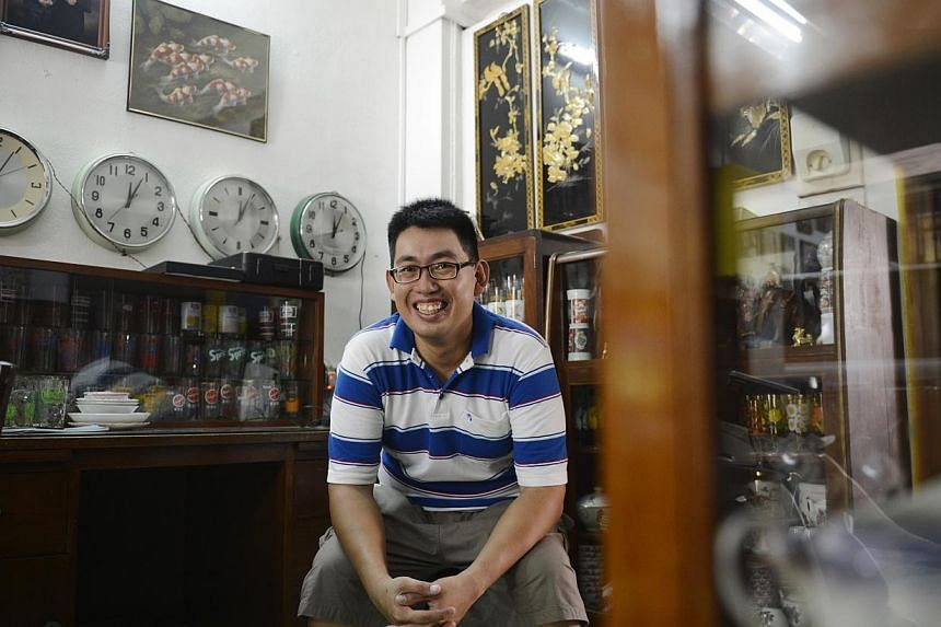 You may be forgiven for thinking you have walked into a museum when you step into Mr David Wee's home along Changi Road. The two-storey terrace house is filled with memorabilia from a bygone era such as 1970s pencil-leg furniture, drinking glass