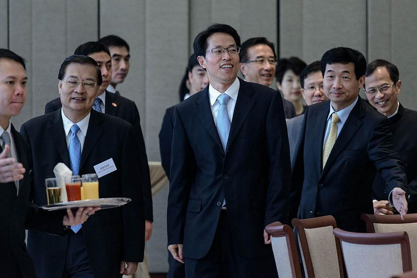 Mr Zhang Xiaoming (centre), head of the city's Beijing liaison, arrives for a luncheon with Hong Kong Legislative Council members and Beijing top officials in Hong Kong on Tuesday, July 16, 2013. China's top representative in Hong Kong held unprecede