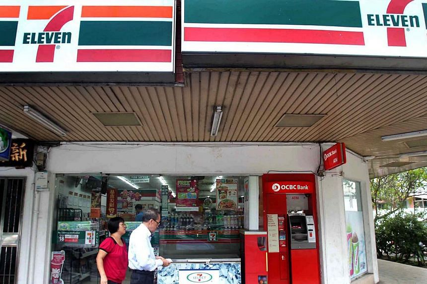 A 7-Eleven outlet on Upper Thomson Road. DBS and POSB customers will now be able to withdraw cash at over 500 7-Eleven stores across the island without having to pay extra fees - as long as they make a purchase at the convenience store. -- FILE PHOTO