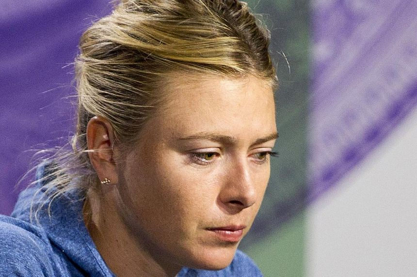 Maria Sharapova of Russia speaks at a news conference after being defeated by Michelle Larcher De Brito of Portugal in their women's singles tennis match at the Wimbledon Tennis Championships, in London on June 26, 2013. Sharapova pulled out of next