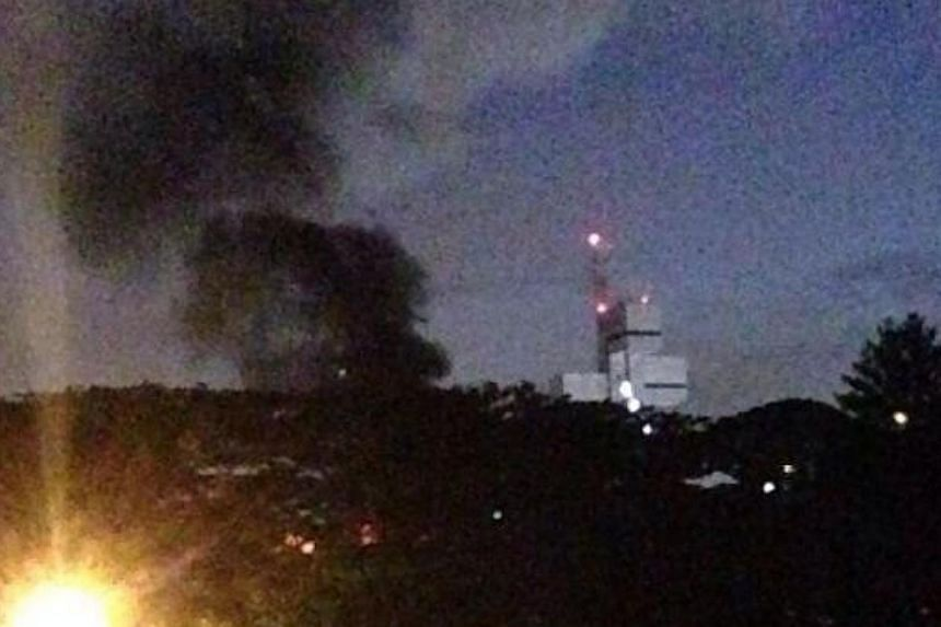 Clouds of black smoke were seen coming out from the campus of Singapore Polytechnic where a fire had broken out, a Singapore Civil Defence Force spokesperson confirmed on Tuesday evening. -- PHOTO: TWITTER OF ANTHONY CHEAH