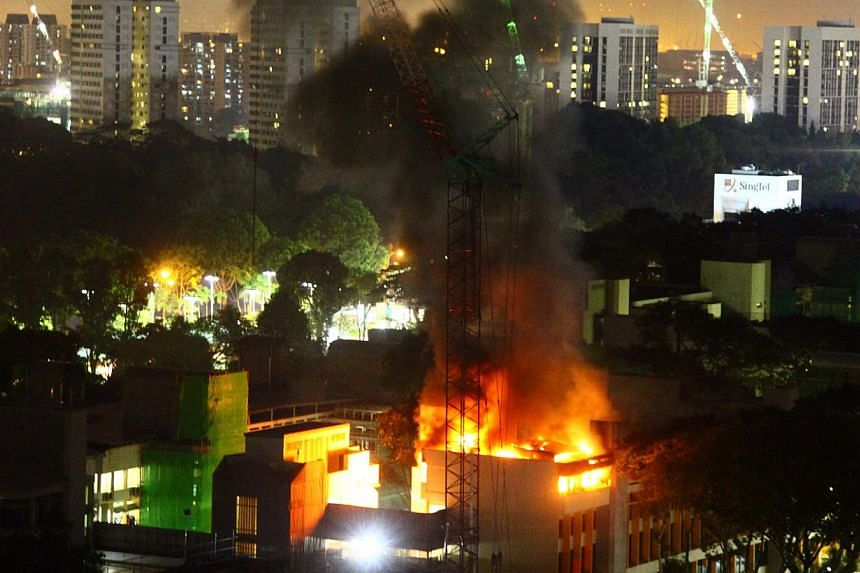 Clouds of black smoke were seen coming out from the campus of Singapore Polytechnic where a fire had broken out, a Singapore Civil Defence Force spokesperson confirmed on Tuesday evening. -- ST PHOTO: KENNY ENG