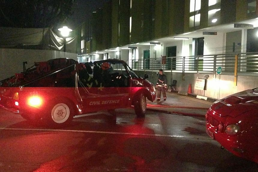 Clouds of black smoke were seen coming out from the campus of Singapore Polytechnic where a fire had broken out, a Singapore Civil Defence Force spokesperson confirmed on Tuesday evening. -- ST PHOTO: RACHEL TAN