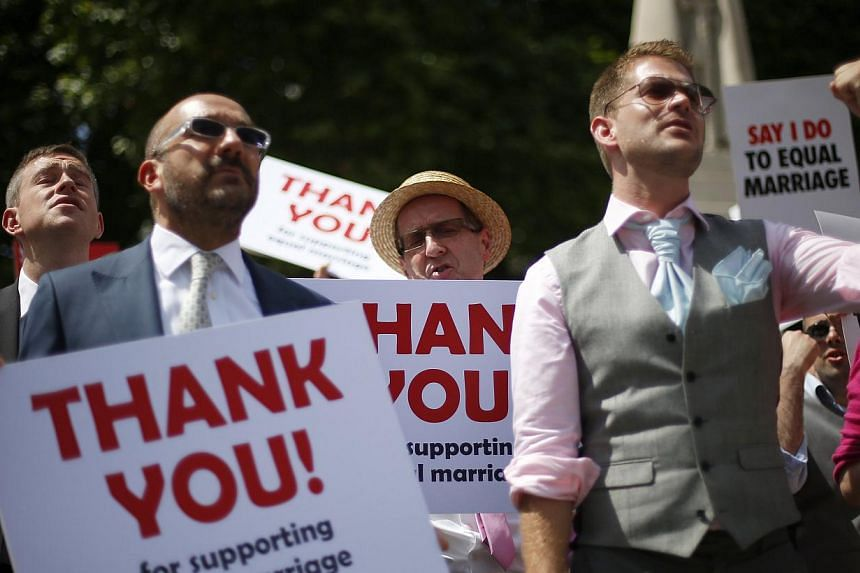Members of the London Gay Men's Choir perform in front of the Houses of Parliament in central London on July 15, 2013. -- FILE PHOTO: REUTERS