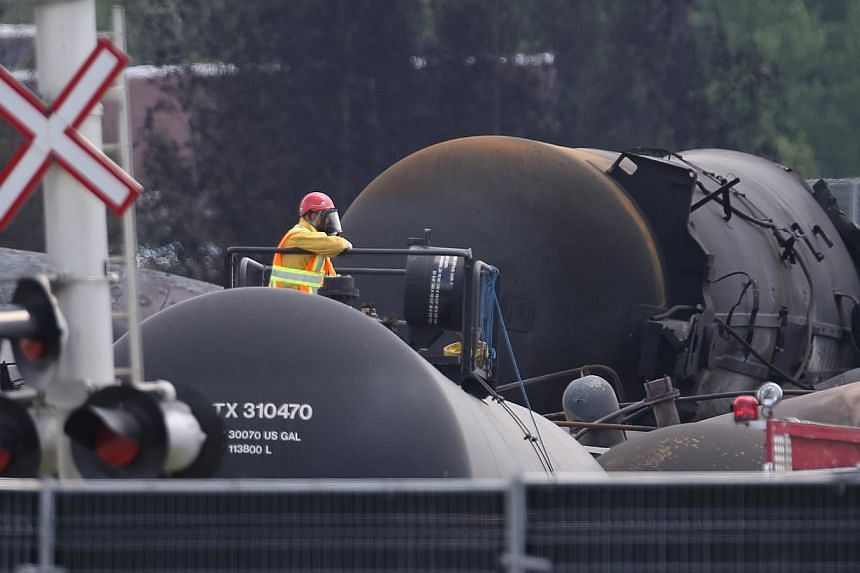 A worker sits on top of a wagon in Lac-Megantic, on July 15, 2013.-- FILE PHOTO: REUTERS