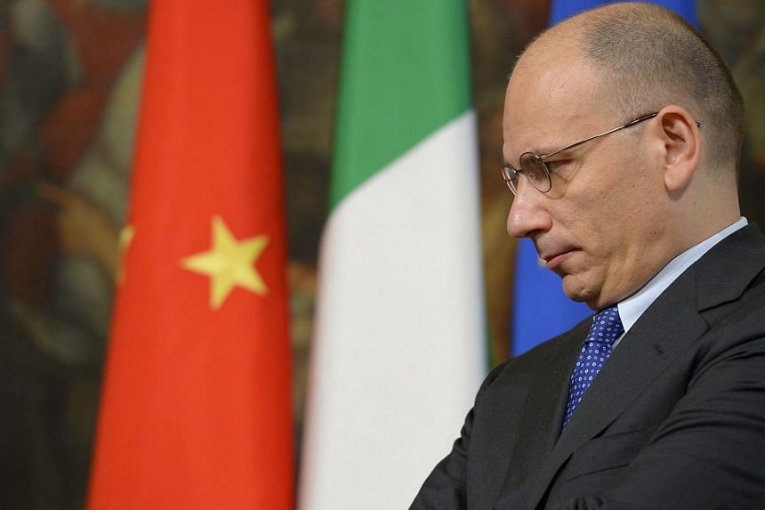 """Italian prime Minister Enrico Letta reacts prior a meeting with Guangdong Province Communist Party on July 16, 2013 at Palazzo Chigi in Rome.Italy's prime minister said on Tuesday that there was a """"huge risk"""" that Britain would leave the Europe"""