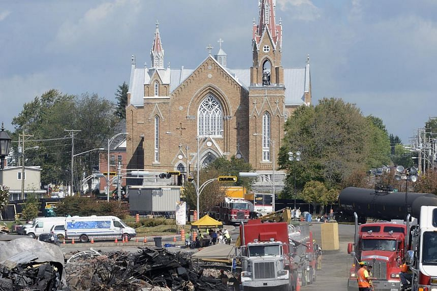 The site of the train wreck is pictured near the Sainte-Agnes church in Lac Megantic, on July 16, 2013.-- FILE PHOTO: REUTERS