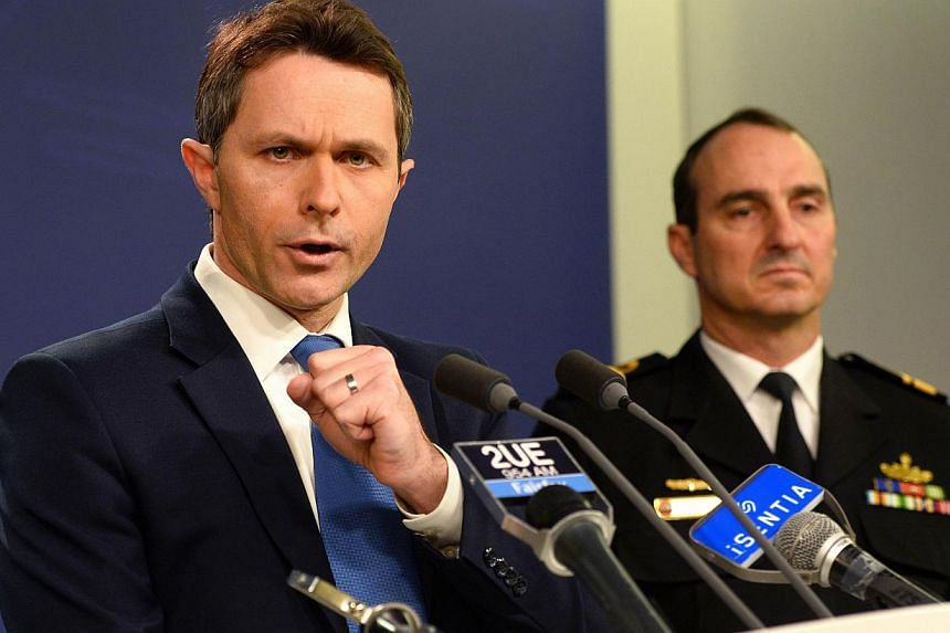 Home Affairs Minister Jason Clare (left) speaks to the media with Commander of Border Protection Command Rear Admiral David Johnston (right), Royal Australian Navy, during a press conference in Sydney on July 17, 2013.Asylum-seekers drowning on