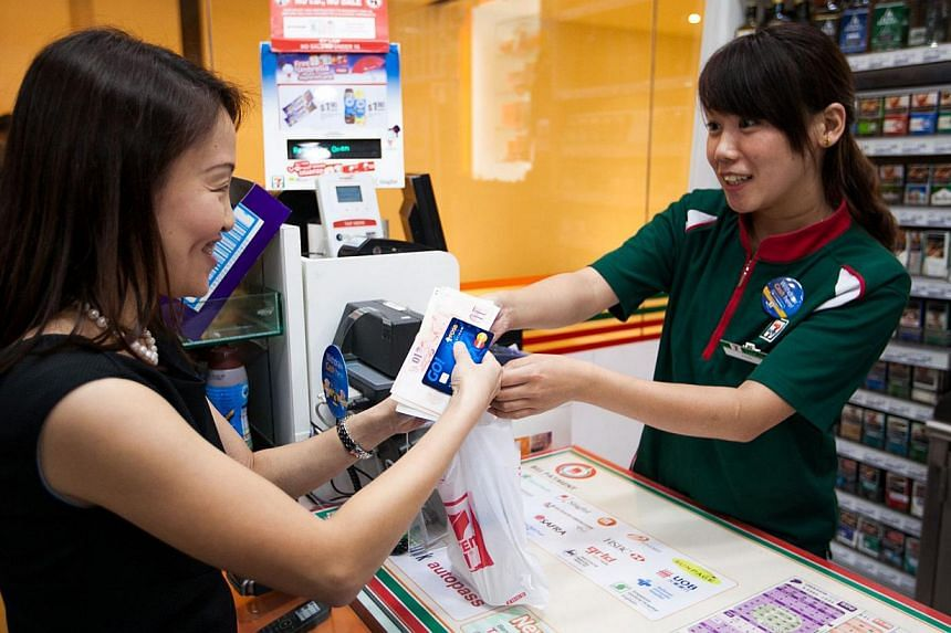 DBS and POSB account holders shopping at 7-Eleven stores can now withdraw cash over the counter as they pay for their items. -- PHOTO: DBS BANK