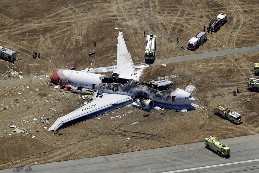The wreckage of Asiana Flight 214 is seen on the ground after it crashed at the San Francisco International Airport, in San Francisco on Saturday, July 6, 2013. Asiana Airlines said on Wednesday, July 17, 2013, it has scrapped a plan to sue a US tele