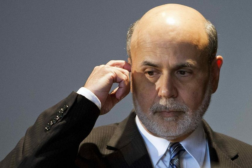 Federal Reserve chairman Ben Bernanke attends a meeting of the National Bureau of Economic Research in Cambridge, Massachusetts on Wednesday, July 10, 2013. Mr Bernanke reiterated on Wednesday, July 17, 2013, that the Fed stimulus could be wound up n