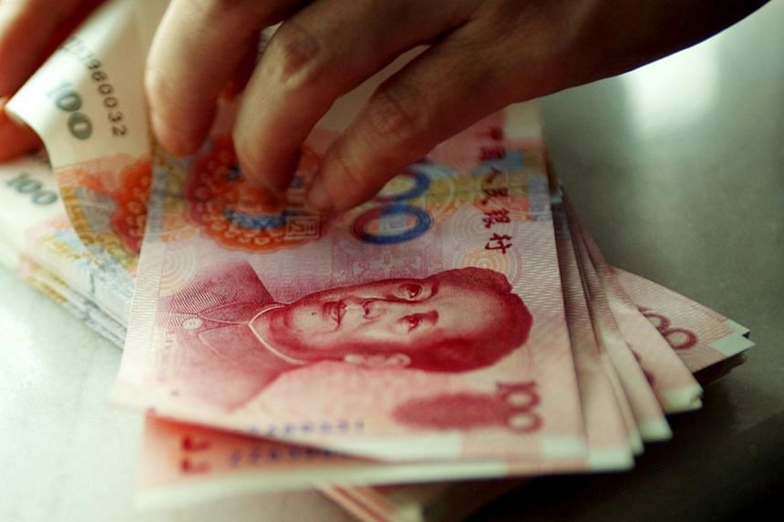 Around 11 per cent of Singapore firms are using the yuan to settle their cross-border transactions, according to a survey from HSBC. -- ST FILE PHOTO: DESMOND WEE