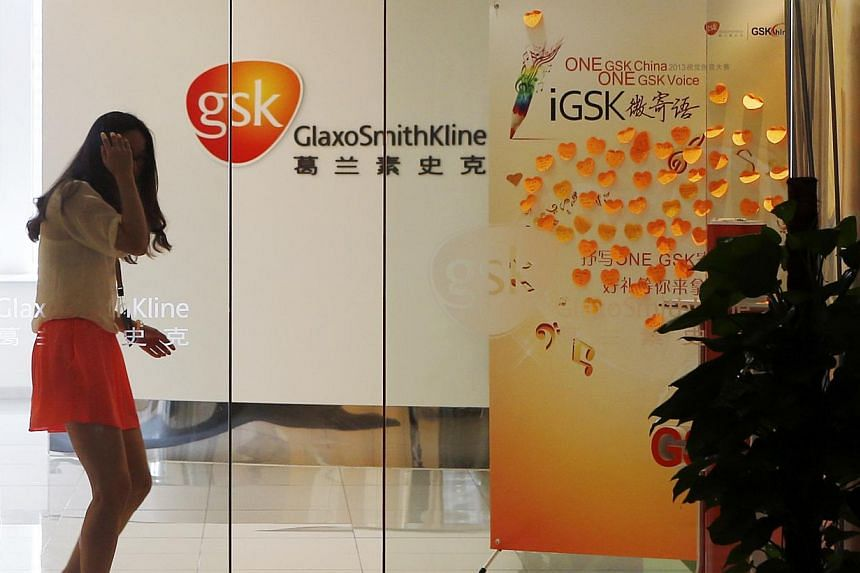 An employee walks inside a GlaxoSmithKline (GSK) office in Shanghai on Tuesday, July 16, 2013. China announced a nationwide crackdown on the sale of illegal medicine on Wednesday and said it would tighten industry regulation, piling pressure on a sec