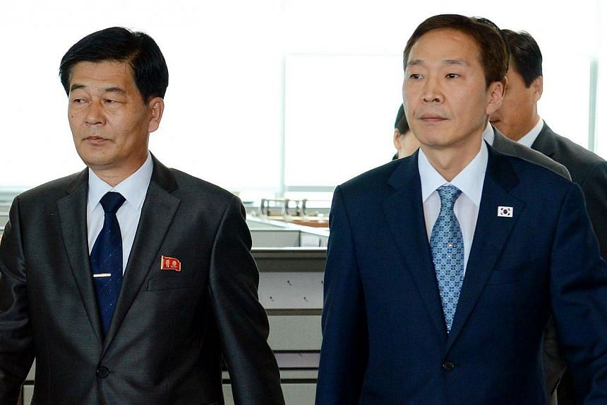 North Korea's chief delegate Pak Chol Su (left) walks with his South Korean counterpart Kim Ki Woong (right) before a fourth round of talks at the Kaesong industrial complex in North Korea on Wednesday, July 17, 2013. North and South Korea failed on