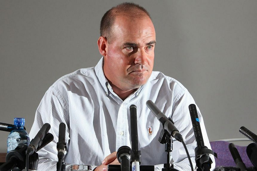 Sacked Australian cricket coach Mickey Arthur speaks to journalists during a press conference in Bristol, south-west England, on Monday, June 24, 2013. Arthur on Wednesday, July 17, 2013, confirmed he was suing Cricket Australia for racial discrimina