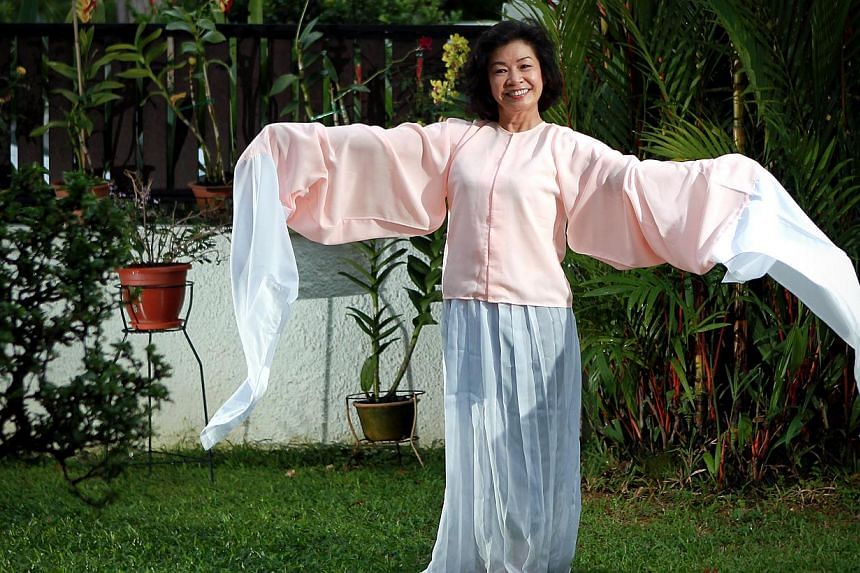 Nose cancer survivor, Mrs Sylvia Khoh, 60, who sings chinese opera, wishes to use her voice to inspire others like her. -- ST PHOTO: NEO XIAOBIN