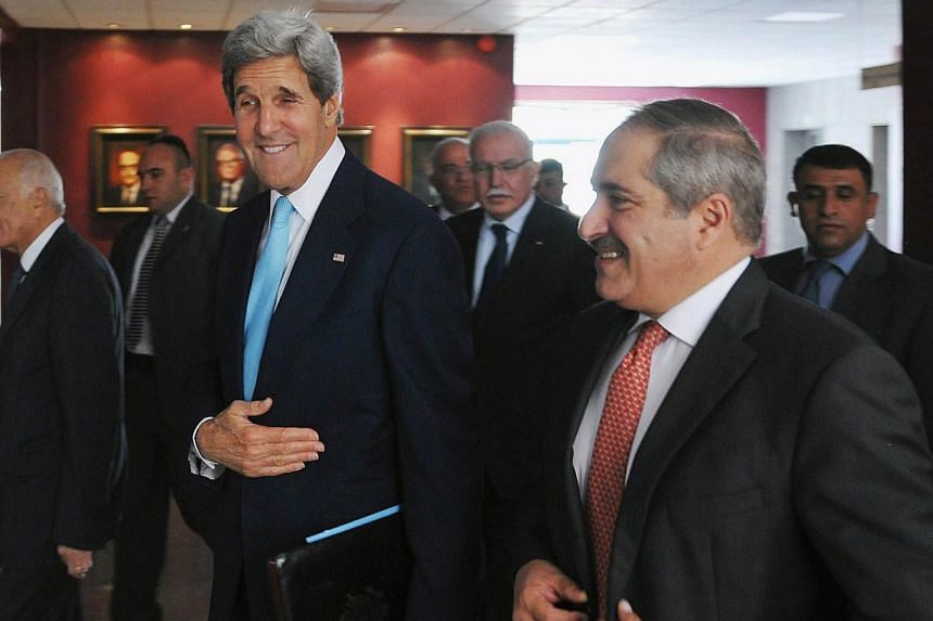 US Secretary of State John Kerry (centre), Jordan's Foreign Minister Nasser Judeh (right) and Egypt's Foreign Minister Mohamed Kamel Amr (left) arrive for a meeting with the Arab League Peace Initiative at the Ministry of Foreign Affairs in Amman on