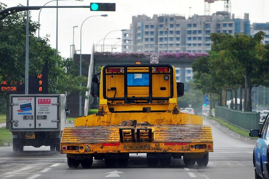 Traffic violations committed by heavy-vehicle drivers increased from 10,882 in 2010 to 12,583 last year. -- ST PHOTO: ALPHONSUS CHERN