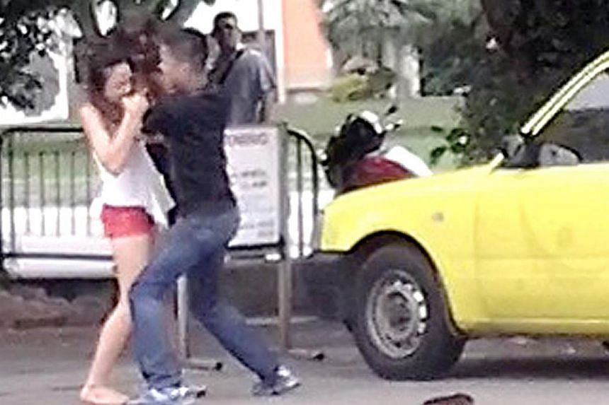 The woman was spotted biting a plainclothes police officer's arm three to four times while trying to escape during a vice raid in Geylang on Sunday. -- PHOTO: SHIN MIN READER