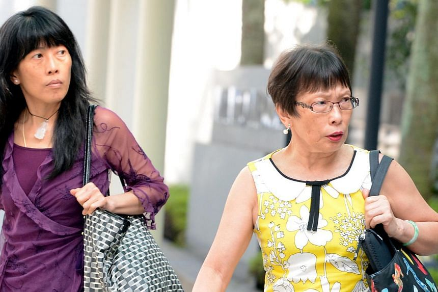 "Madam Yvonne Goh Mei Ling (right), seen here with sister Yvette Goh Meich'ang on April 4, 2013, who is being sued over a Housing Board flat by her mother, claimed on Wednesday, July 17, 2013, that 91-year-old widow Eileen Chia Yoke Mui had been ""put"