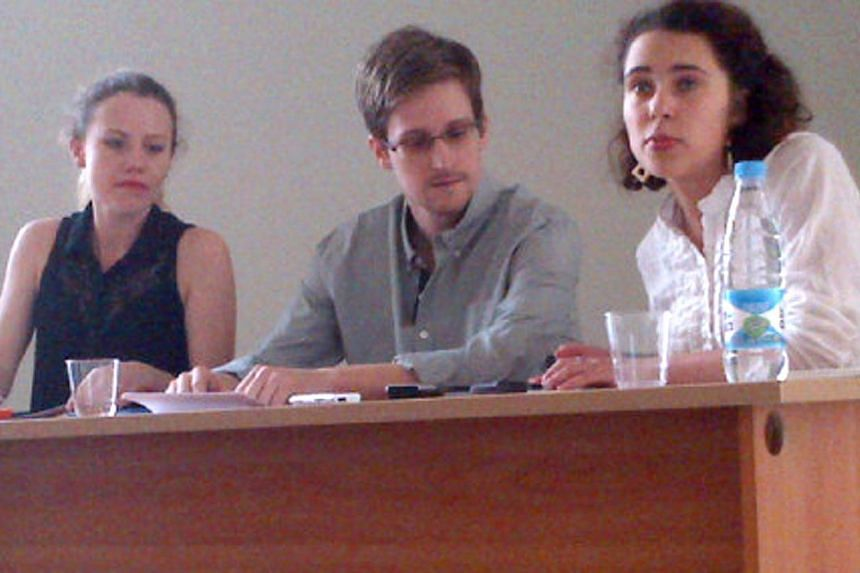 Picture released by Human Rights Watch shows US National Security Agency (NSA) fugitive leaker Edward Snowden (centre) during a meeting with rights activists, with among them Sarah Harrison of WikiLeaks (left), at Moscow's Sheremetyevo airport, on Fr