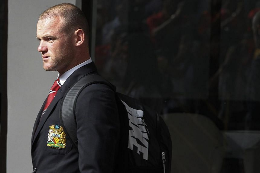 Manchester United's Wayne Rooney arrives at Don Muang International Airport in Bangkok on Thursday, July 11, 2013. Manchester United rejected Chelsea's opening offer for Rooney on Tuesday, July 16, 2013, and remained insistent the England striker is