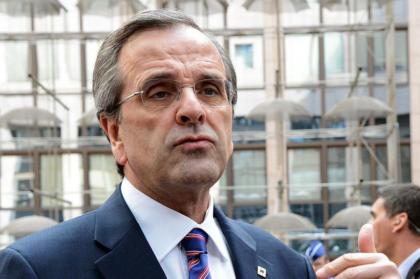Greek Prime Minister Antonis Samaras (above) on Wednesday, July 17, 2013, was caught swearing on camera as he fumbled a long-awaited announcement on tax relief. -- FILE PHOTO: AFP
