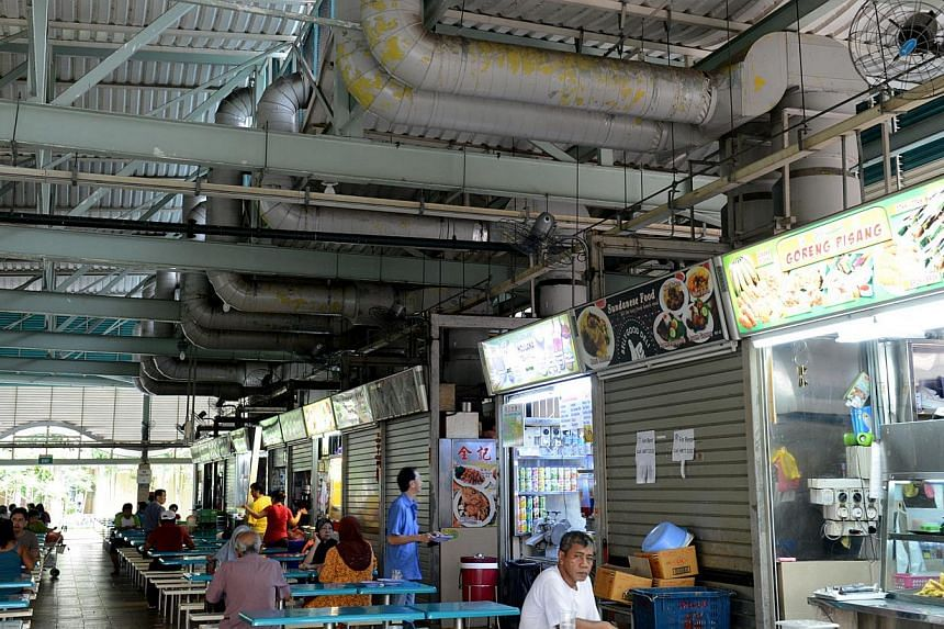 Ceiling exhaust pipes are seen at Kaki Bukit hawker centre at Block 511 Bedok North Street 3. A second representative of the markets involved in the long-running hawker centre cleaning dispute has confirmed that he is a People's Action Party (PAP) me
