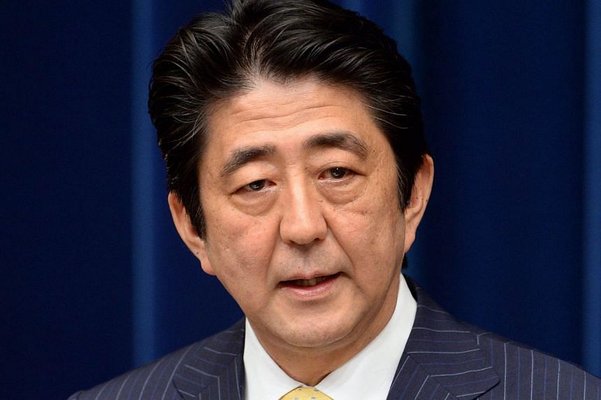 Japanese Prime Minister Shinzo Abe (above) on Wednesday, July 17, 2013, visited coastguards who patrol waters around islands at the centre of a dispute with China, as election campaigning stepped up a gear. -- FILE PHOTO: AFP