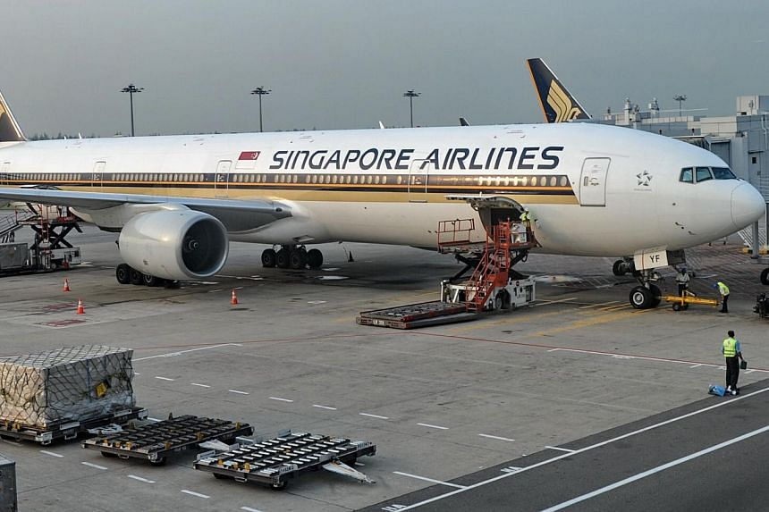 A Singapore Airlines (SIA) Boeing 777-312 is seen parked at the Changi International airport terminal in Singapore on June 28, 2013. SIA has decided to allow customers to use both cash and their KrisFlyer miles to pay for flights. This is for the ful