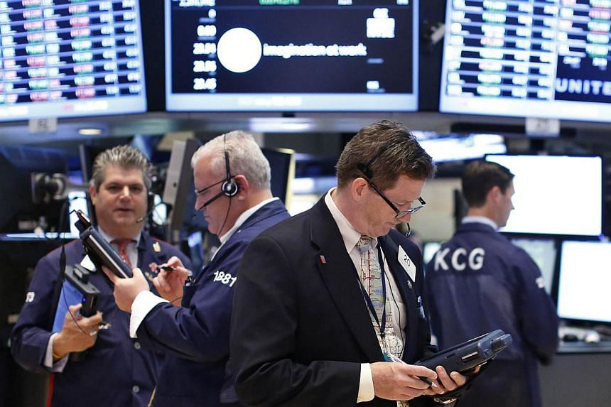 Traders work on the floor at the New York Stock Exchange, July 17, 2013. United States (US) stocks ended modestly higher on Wednesday after Federal Reserve chairman Ben Bernanke said the timeline for winding down the US central bank's stimulus progra